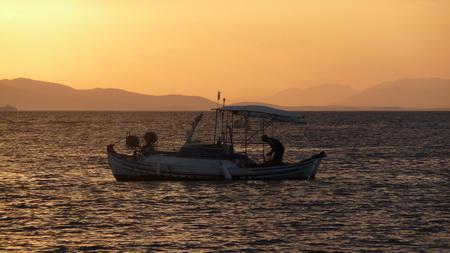Fischer in Abenddämmerung